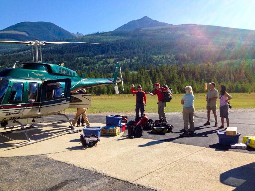 Guests loading gear into heli at Valemount for their hiking vacation