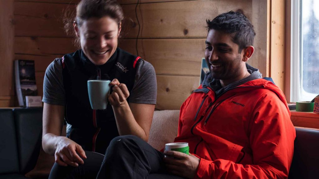 couple enjoying a coffee inside the mallard mountain lodge