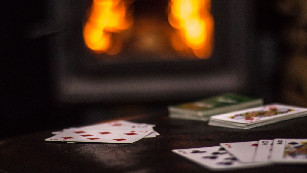 card games by a warm fire in the backcountry ski and hiking lodge